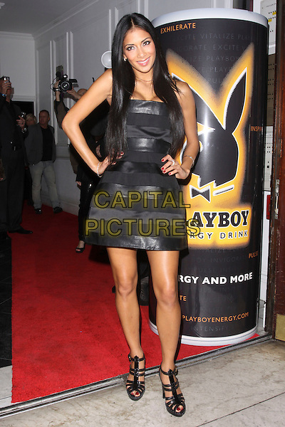 NICOLE SCHERZINGER .Attending the Playboy Energy Drink UK Launch Party at Funky Buddha, London, England, UK, November 18th 2010..full length  black dress hands on hips strapless platform sandals .CAP/AH.©Adam Houghton/Capital Pictures.