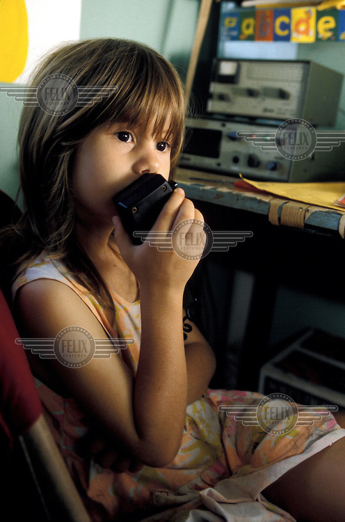 'School of the air' - a young girl speaking to her teacher by CB radio from her remote home at Murwangi cattle station.