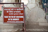Agra, India.  Agra Fort.  Sign Asking Visitors not to Deface the Buildings.  Anti-Graffiti Request.