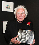 Joe Sirola, holding up a photograph of himself with Tammy Grimes, attends the '12th Annual Love N' Courage' celebrating David Amram and Tammy Grimes at The Players Club on March 2,, 2015 in New York City.