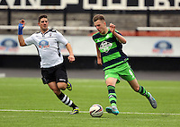 Pictured: Keston Davies (R) of Swansea charges forward Saturday 11 July 2015<br />