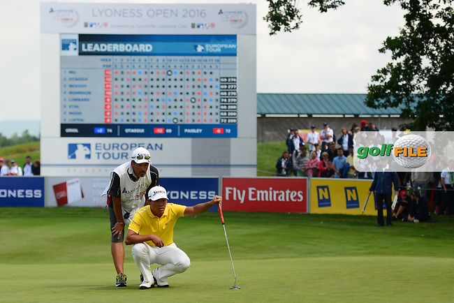 Ashun Wu of China lines up on the 18th green during Round 4 of the Lyoness Open, Diamond Country Club, Atzenbrugg, Austria. 12/06/2016<br /> Picture: Richard Martin-Roberts / Golffile<br /> <br /> All photos usage must carry mandatory copyright credit (&copy; Golffile | Richard Martin- Roberts)