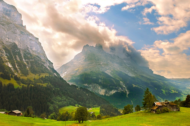 The Eiger in Clouds at sunset above Grindelwld, Swiss Alps, Switzerland