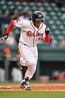 Catcher Roldani Baldwin (16) of Greenville Drive bats in a game against the Greensboro Grasshoppers on Tuesday, April 25, 2017, at Fluor Field at the West End in Greenville, South Carolina. Greenville won, 5-1. (Tom Priddy/Four Seam Images)