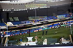 The players warming-up is reflected in the security box window before Ipswich Town play Oxford United in a SkyBet League One fixture at Portman Road. Both teams were in contention for promotion as the season entered its final months. The visitors won the match 1-0 through a 44th-minute Matty Taylor goal, watched by a crowd of 19,363.