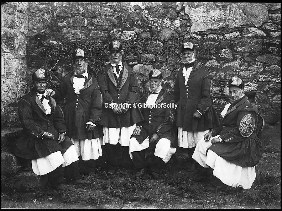 BNPS.co.uk (01202 558833)<br /> Pic: GibsonOfScilly/BNPS<br /> <br /> Lord St Levan's boatmen.<br /> <br /> An archive of eye-opening photographs documenting the grim reality of Poldark's Cornwall has emerged for sale for &pound;25,000.<br /> <br /> More than 1,500 black and white images show the gritty lives lived by poverty-stricken families in late 19th and early 20th century Cornwall - around the same time that Winston Graham's famous Poldark novels were set.<br /> <br /> The collection reveals the lowly beginnings of towns like Rock, Fowey, Newquay and St Ives long before they became picture-postcard tourist hotspots.<br /> <br /> Images show young filth-covered children playing barefoot in squalid streets, impoverished families standing around outside the local tax office, and weather-beaten fishwives tending to the day's catch.<br /> <br /> The Cornish archive, comprising 1,200 original photographic prints and 300 glass negative plates, is tipped to fetch &pound;25,000 when it goes under the hammer as one lot at Penzance Auction House.