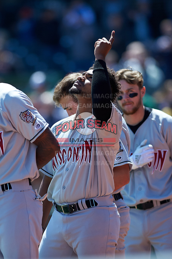 Wisconsin Timber Rattlers Wilfred Salaman (21) during the National Anthem before a Midwest League game against the Great Lakes Loons at Dow Diamond on May 4, 2019 in Midland, Michigan. Great Lakes defeated Wisconsin 5-1. (Zachary Lucy/Four Seam Images)