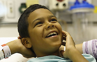 Derick Byrd smiles at his mom Terra before going into surgery at Children's Hospital, Friday June 17, 2005, in Columbus, Ohio. Derick's surgery was a non-invasive procedure using an electromagnetic field to create heat that softens a polymer, allowing Derick's plastic and titanium prosthesis to expand.<br />