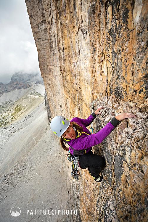 Female climber on the Comici Route, Tre Cime di Lavaredo / Drei Zinnen,  Italian Dolomites