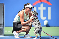 Washington, DC - August 4, 2019: Jessica Pegula (USA) celebrates with her dog Mattie after defeating Camila Giorgi (ITA) in the WTA Citi Open Woman's Finals at Rock Creek Tennis Center, in Washington D.C. (Photo by Philip Peters/Media Images International)