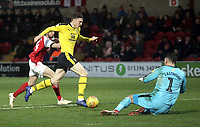 Oxford United's Rob Dickie shepherds the ball back to \his keeper Simon Eastwood under pressure from Fleetwood Town's Ashley Nadesan<br /> <br /> Photographer Rich Linley/CameraSport<br /> <br /> The EFL Sky Bet League One - Fleetwood Town v Oxford United - Saturday 12th January 2019 - Highbury Stadium - Fleetwood<br /> <br /> World Copyright &copy; 2019 CameraSport. All rights reserved. 43 Linden Ave. Countesthorpe. Leicester. England. LE8 5PG - Tel: +44 (0) 116 277 4147 - admin@camerasport.com - www.camerasport.com