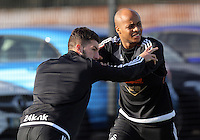 SWANSEA, WALES - JANUARY 28: Andre Ayew (R) warms up during the Swansea City Training Session on January 28, 2016 in Swansea, Wales.