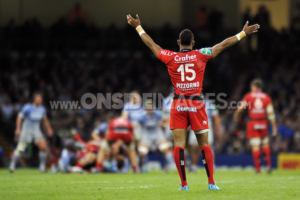 Delon Armitage throws his hands into the air as he watches play. Heineken Cup Final, between Toulon and Saracens on May 24, 2014 at the Millennium Stadium in Cardiff, Wales. Photo by: Patrick Khachfe / JMP