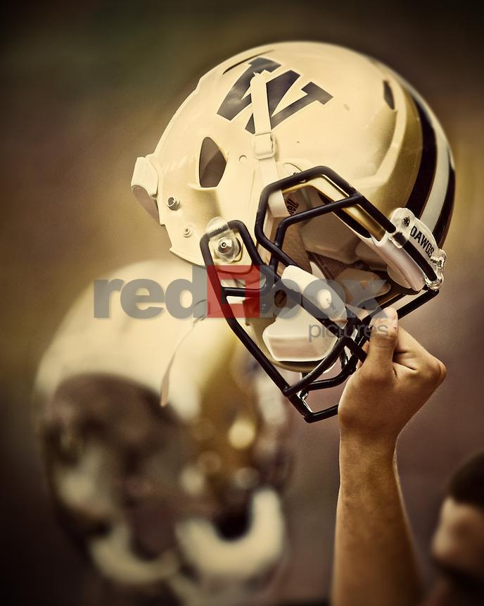 UW, helmet, hand<br /> <br /> ---------University of Washington (UW) vs. University of California-Berkley (Cal) at Husky Stadium on Saturday, September 24, 2011. (Photo by Dan DeLong/Red Box Pictures)