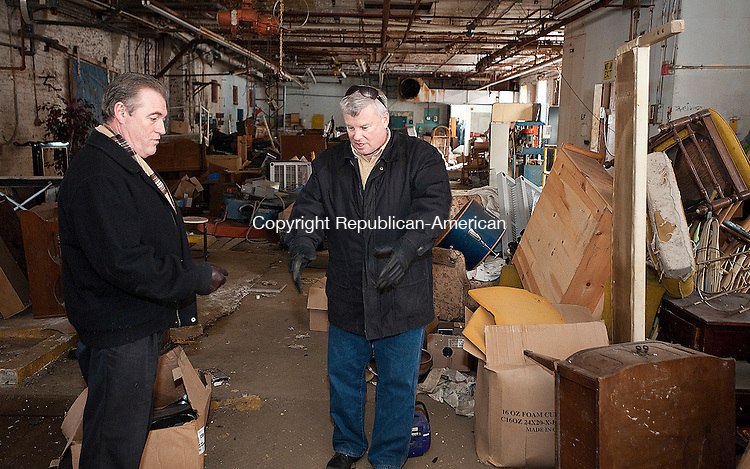 WINSTED, CT-012014JS02- Winsted Town Manager Dale L. Martin, right, talks with Robert Robinson, supervising analyst with the remediation division of the Connecticut Department of Energy and Environmental Protection during a tour of the former Lambert Kay building in Winsted on Tuesday. <br /> Jim Shannon Republican-American