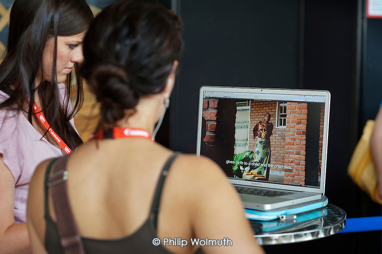 Photographers show their work to picture editors at the Visa Pour L'Image festival of photojournalism, Perpignan, France.