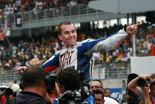 10.10.2010:  Jorge Lorenzo of Fiat Yamaha Team celebrate at the parc ferme of MotoGP class after sealed his world champion in the premier motorcycle class with a third place finish of the Malaysian Motorcycle Grand Prix held at Sepang International Circuit in Sepang, Malaysia..