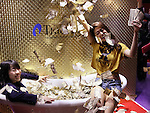 """April 30, 2016, Chiba, Japan - A model scatters toy banknotes in a bath to enjoy feelong of billionaires at a booth of online security company Monex during the Niconico Chokaigi in Chiba on Saturday, April 30, 2016. Some 150,000 visitors enjoyed over 100 booths including games, hobbies, sports, politics as well as Japan's sub cultures at the two-day offline meeting sponsored by Japan's video sharing website """"Niconico Douga"""".  (Photo by Yoshio Tsunoda/AFLO) LWX -ytd-"""