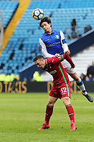 Adam Reach of Sheffield Wednesday heads the ball over Connor Roberts of Swansea City during The Emirates FA Cup Fifth Round match between Sheffield Wednesday and Swansea City at Hillsborough, Sheffield, England, UK. Saturday 17 February 2018
