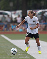 Portland Thorns FC midfielder Tobin Heath (17) looks to pass. In a National Women's Soccer League (NWSL) match, Portland Thorns FC (white/black) defeated Boston Breakers (blue), 2-1, at Dilboy Stadium on July 21, 2013.