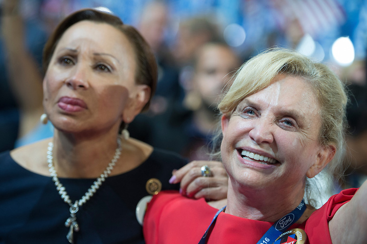 UNITED STATES - JULY 28: Reps. Nydia Velazquez, D-N.Y., left, and Carolyn Maloney, D-N.Y., cheer on the floor of the Wells Fargo Center in Philadelphia, Pa., on the final night of the Democratic National Convention, July 28, 2016, at which Democratic presidential nominee Hillary Clinton addressed the crowd. (Photo By Tom Williams/CQ Roll Call)
