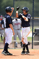 GCL Yankees 2 shortstop Angel Aguilar (2) fist bumps Tyler Palmer (31) after hitting a home run during a game against the GCL Braves on June 23, 2014 at the Yankees Minor League Complex in Tampa, Florida.  GCL Yankees 2 defeated the GCL Braves 12-4.  (Mike Janes/Four Seam Images)