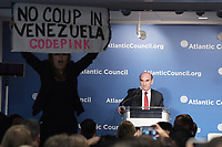 Washington, DC - April 25, 2019: a protester interrupts Elliott Abrams, Special Representative for Venezuela at the Department of State, as he speaks at the Atlantic Council in Washington, D.C., April 25, 2019.  (Photo by Lenin Nolly/Media Images International)