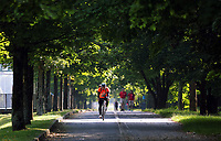 WEATHER PICTURE WALES<br />Pictured: A cyclist rides along the Oystermouth Road path in Swansea Bay, Wales, UK. Wednesday 21 June 2017<br />Re: A prolonged period of sunshine and high temperatures has caused one of the longest heatwaves in the UK.