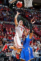 Ohio State Buckeyes guard Aaron Craft (4) gets past Delaware Blue Hens guard Jarvis Threatt (4) during the first half of the NCAA men's basketball game at Value City Arena on Wednesday, December 18, 2013. (Columbus Dispatch photo by Jonathan Quilter)