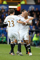 Andre Ayew celebrates scoring his sides second goal with Jack Cork and Gylfi Sigurdsson during the Barclays Premier League match between Everton and Swansea City played at Goodison Park, Liverpool