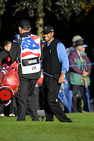 Ryder Cup 206 K Club, Straffin, Ireland...American Ryder Cup team player Tiger Woods shares a joke with his cabby on the fairway of the second hole during  the  morning fourballs session of the second day of the 2006 Ryder Cup at the K Club in Straffan, Co Kildare, in the Republic of Ireland, 23 September 2006...Photo: Eoin Clarke/ Newsfile.