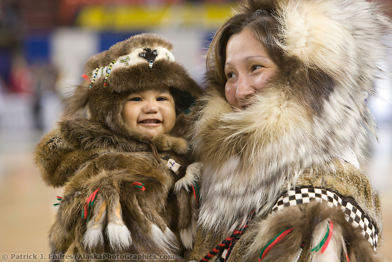 Carla Lapierre models a Yupik parka made of tundra squirrel with wolf ruff and calf skin patterns and beaver and wolf. Her daughter is wearing a beaver parka and hat with seal skin bottoms. All made by her late grandmother Lucy Beaver of Bethel Alaska. 2007 World Eskimo Indian Olympics held in Anchorage, Alaska.