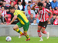 Norwich City's Christoph Zimmerman shields the ball from Lincoln City's Matt Green<br /> <br /> Photographer Andrew Vaughan/CameraSport<br /> <br /> Football Pre-Season Friendly - Lincoln City v Norwich City - Tuesday 10th July 2018 - Sincil Bank - Lincoln<br /> <br /> World Copyright &copy; 2018 CameraSport. All rights reserved. 43 Linden Ave. Countesthorpe. Leicester. England. LE8 5PG - Tel: +44 (0) 116 277 4147 - admin@camerasport.com - www.camerasport.com