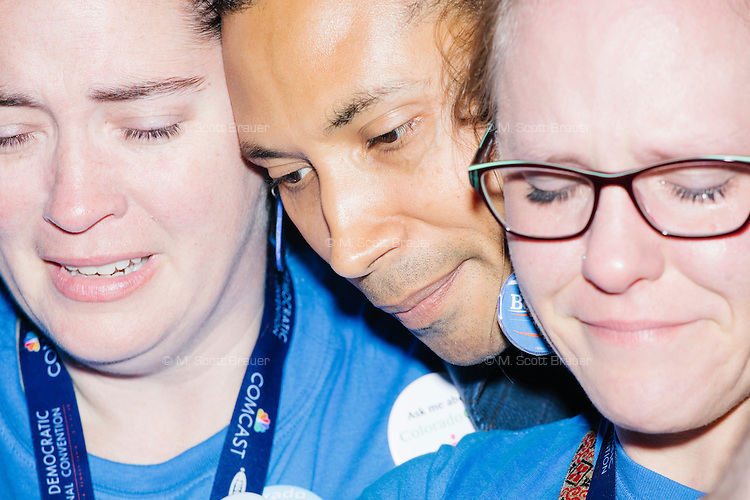 "Anthony E. Graves, a Clinton delegate for Colorado, consoles two Sanders delegates from Colorado after the official nomination of Hillary Clinton at the Democratic National Convention at the Wells Fargo Center in Philadelphia, Pennsylvania, on Tues., July 26, 2016. Graves said that he told the two Bernie supporters that he appreciated what Sanders and his supporters did for the party during this election and that ""their revolution will continue"" in down-ballot elections over the coming years. Soon after this moment, a number of Bernie delegates walked out of the convention and occupied the media tent outside the arena in protest."