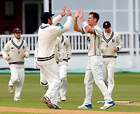 Matt Henry (R) of Kent enjoys a high five with Grant Stewart after taking the wicket of Chris Dent during the County Championship Division 2 game between Kent and Gloucestershire at the St Lawrence Ground, Canterbury, on April 15, 2018.
