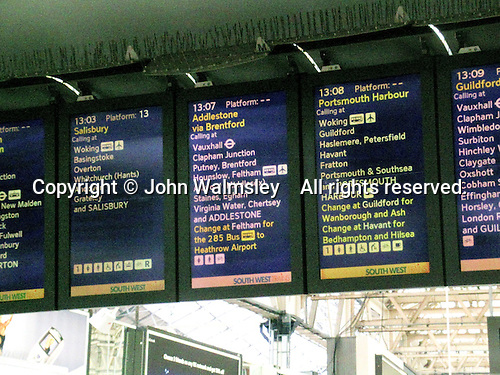 Departure signs at Waterloo train station, London.