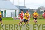 Brosna's Flor McAuliffe being chased down by Emmet's Cormac Mulvihill.