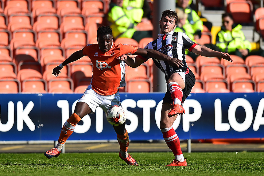 Blackpool's Bright Osayi-Samuel competes with Grimsby Town's Danny Andrew<br /> <br /> Photographer Richard Martin-Roberts/CameraSport<br /> <br /> The EFL Sky Bet League Two - Blackpool v Grimsby Town - Saturday 8th April 2017 - Bloomfield Road - Blackpool<br /> <br /> World Copyright &copy; 2017 CameraSport. All rights reserved. 43 Linden Ave. Countesthorpe. Leicester. England. LE8 5PG - Tel: +44 (0) 116 277 4147 - admin@camerasport.com - www.camerasport.com