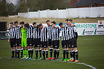 The home players observing a minute's silence at Victory Park, before Chorley played Altrincham (in yellow) in a Vanarama National League North fixture. Chorley were founded in 1883 and moved into their present ground in 1920. The match was won by the home team by 2-0, watched by an above-average attendance of 1127.