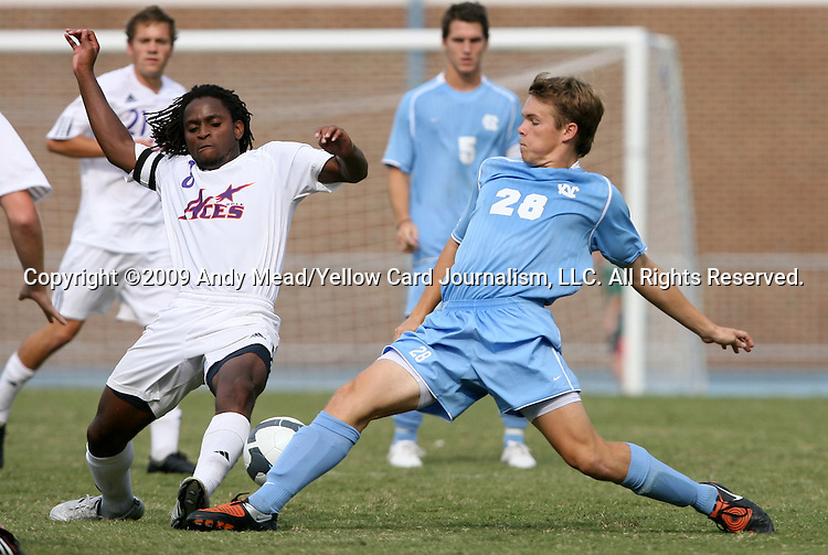 06 September 2009: Evansville's Reggie Edu (8) and UNC's Alex Waters (28). The University of North Carolina Tar Heels defeated the Evansville University Purple Aces 4-0 at Fetzer Field in Chapel Hill, North Carolina in an NCAA Division I Men's college soccer game.