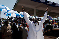 Led by the self-styled prophet David Owuor, tens of thousands of Kenyans camped out in Uhuru Park over the weekend of 23 February 2013 to renounce violence in the lead up to the historic elections on 4 March, the first since the post-election violence of 2007/08  that left more than 1,200 dead and 600,000 displaced. Prophet David Owuor salutes the crowd upon arrival at Uhuru Park.