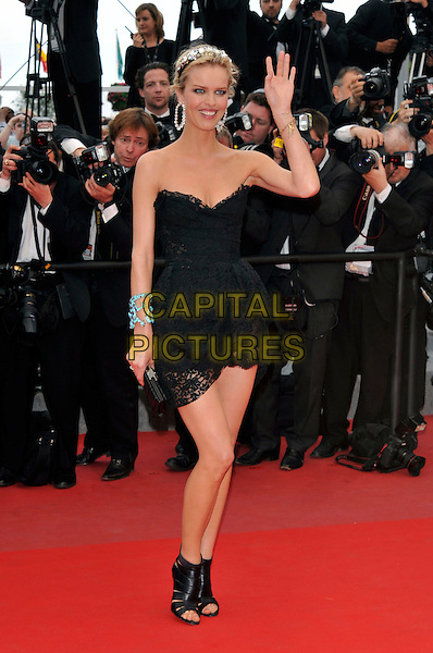 EVA HERZIGOVA.'La Princesse de Montpensier' premiere at the 63rd International Cannes Film Festival, Cannes, France, .16th May 2010..full length dress strapless black cleavage jewelled gem encrusted embellished crystals headband head hair band hairband lace mini walking open toe shoes booties shooboots ankle boots  hand waving clutch bag .CAP/PL.©Phil Loftus/Capital Pictures.