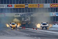 Apr. 26, 2013; Baytown, TX, USA: NHRA funny car driver Del Worsham (left) alongside Tony Pedregon during qualifying for the Spring Nationals at Royal Purple Raceway. Mandatory Credit: Mark J. Rebilas-
