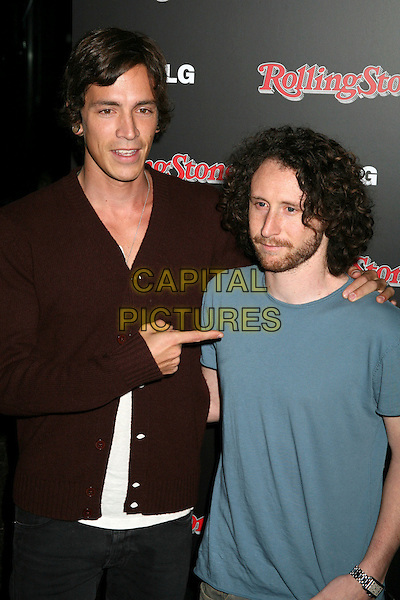 BRANDON BOYD & GUEST.Rolling Stone Magazine Celebrates the 20th Annual HOT LIST at the Sofitel Hotel's Stone Rose Lounge, Los Angeles, California, USA..October 3rd, 2006.Ref: ADM/BP.half length brown blue pointing.www.capitalpictures.com.sales@capitalpictures.com.©Byron Purvis/AdMedia/Capital Pictures.