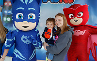 NWA Democrat-Gazette/DAVID GOTTSCHALK Morgan Pitcher holds her son Lucas, 1, as they stand with PJ Masks characters Friday, November 2, 2018, during First Friday/Toyland in downtown Bentonville. Hosted by Downtown Bentonville Inc., the event featured Walmart venders bringing out toys and lifesize characters to give out toys, promotional items and to interact with visitors.