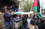 Mourners carry the body of Palestinian Rahiq Birawi, who according to the Israeli police was shot dead after she had advanced towards them with a knife in her hand at a checkpoint last October, during her funeral after Israel released her body, in the West Bank village of Aseera Ashamaliya near Nablus December 17, 2016. Photo by Nedal Eshtayah