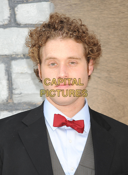 "T.J. MILLER .arriving at the Los Angeles premiere of ""Yogi Bear"" in Westwood Village, California, USA, December 11th, 2010. .portrait headshot red bow tie .CAP/ROT/TM.©TM/Roth StockCapital Pictures"