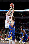 SIOUX FALLS, SD: MARCH 6: Tyler Flack #23 from the University of South Dakota shoots a jumper over Mike Daum #24 from South Dakota State University during the Summit League Basketball Championship on March 6, 2017 at the Denny Sanford Premier Center in Sioux Falls, SD. (Photo by Dave Eggen/Inertia)