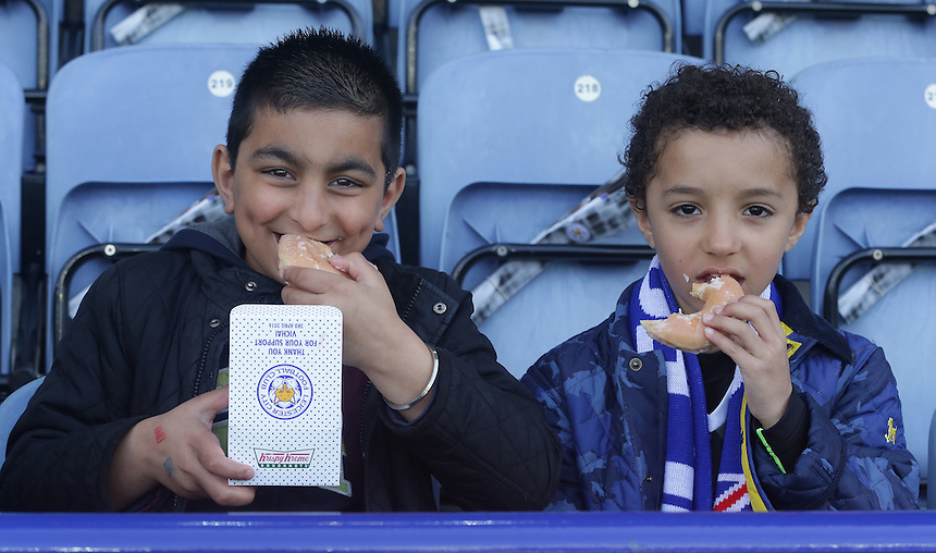 Leicester City owner Vichai Srivaddhanaprabha arranged for all fans at todays match to be given a free bottle of beer and a donut<br /> <br /> Photographer Stephen White/CameraSport<br /> <br /> Football - Barclays Premiership - Leicester City v Southampton - Sunday 3rd April 2016 - King Power Stadium - Leicester<br /> <br /> &copy; CameraSport - 43 Linden Ave. Countesthorpe. Leicester. England. LE8 5PG - Tel: +44 (0) 116 277 4147 - admin@camerasport.com - www.camerasport.com