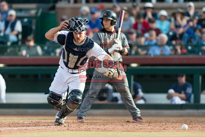 Peoria Javelinas catcher Joe DeCarlo (4), of the Seattle Mariners organization, chases a passed ball in front of Daulton Varsho (8) during the Arizona Fall League Championship Game against the Salt River Rafters at Scottsdale Stadium on November 17, 2018 in Scottsdale, Arizona. Peoria defeated Salt River 3-2 in 10 innings. (Zachary Lucy/Four Seam Images)